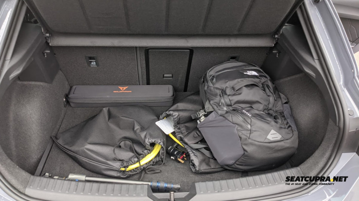 A boot with a bag and charging cable