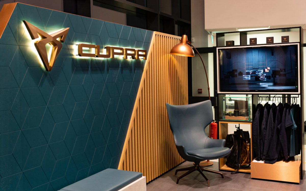 CUPRA seating area with merchandise