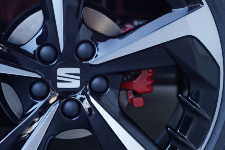 Close up of a SEAT wheel with red brake callipers