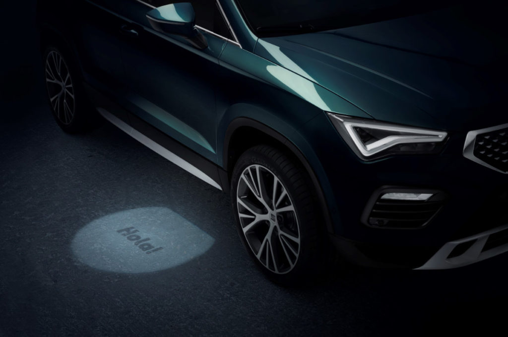 "2020 Ateca down light from the mirror saying ""hola!"""