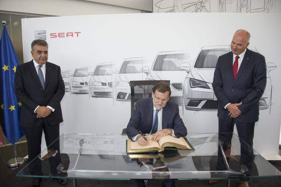 Spanish Prime Minister Mariano Rajoy signs the SEAT book of honour during his visit to Martorell facilities.